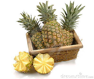 Basket With Pineapples Stock Images.