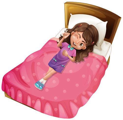 Happy girl lying on pink bed.