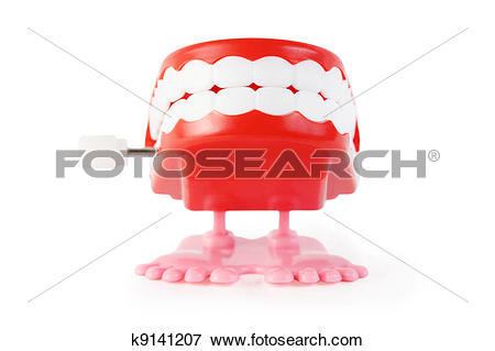 Picture of bright toy clockwork jaw with white teeth on pink legs.