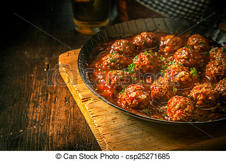 Pictures of Savory beef mince meatballs in a piquant sauce.
