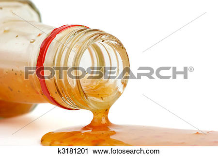 Stock Photography of Piquant red sauce leaking from the bottle.