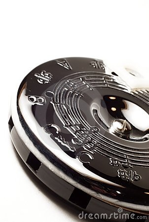 Silver Circle Pitch Pipe For Music Stock Photo.