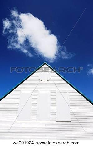 Stock Photo of Cloud and wooden building with pitched roof.