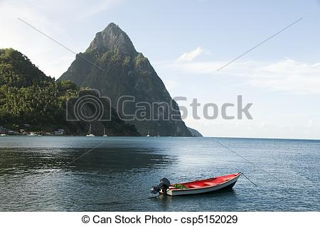 Stock Photographs of Caribbean Sea native fishing boat with view.