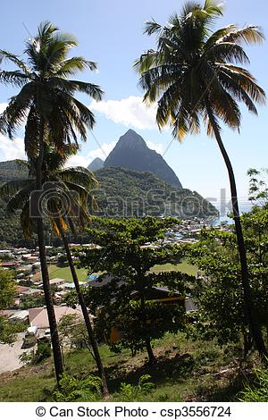 Stock Photo of Pitons as seen from Soufriere beach framed by palm.