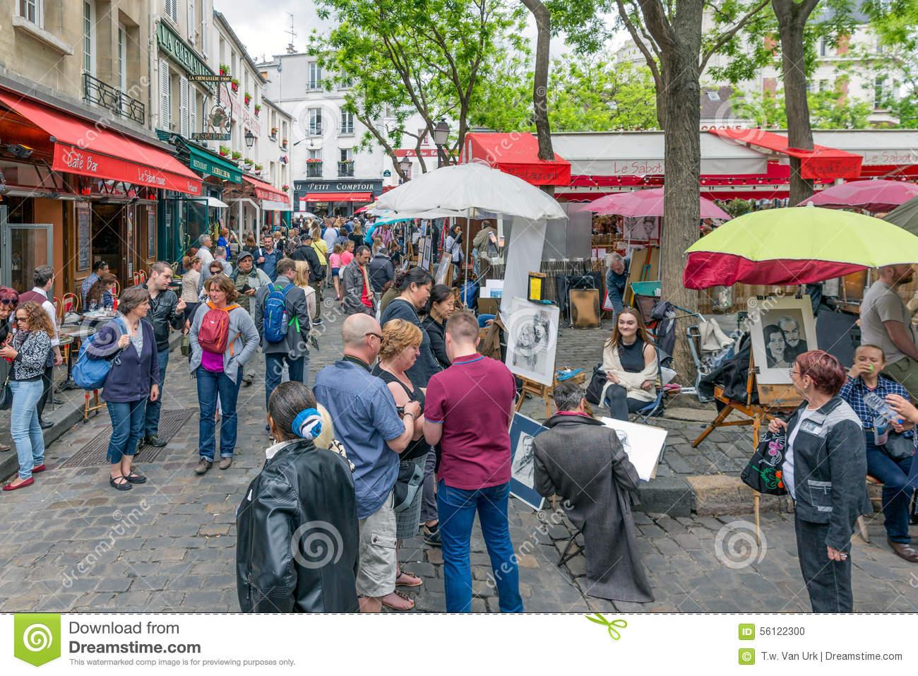 Tourists Visiting Place Du Tertre In Montmartre, Paris, France.