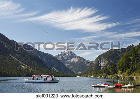 Stock Photo of Austria, Tyrol, Tourist in boat on lake plansee.