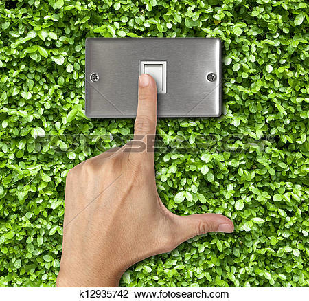 Stock Photo of human finger turn off switch on Plant Background.