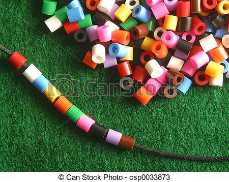 Stock Photos of stringing beads.