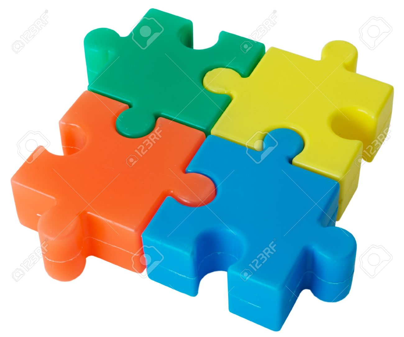 Plastic Colored Figure From Slices Puzzle On The White Background.