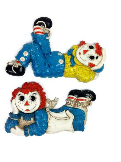 Vintage Raggedy Ann and Andy plastic wall hangings, cool 70s.