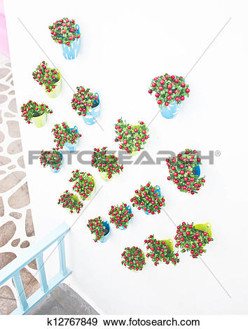 Stock Photograph of Plastic flowers with colorful plastic vase.
