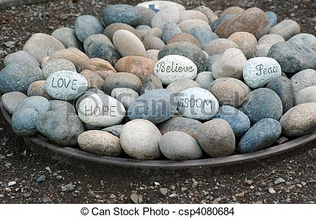 Stock Photo of words of wisdom in a plate of rocks.