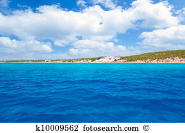 Man sunbathing beach platja de migjorn north coast formentera.