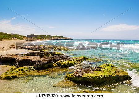 Stock Photography of Platja de Sant Tomas beach at Menorca island.