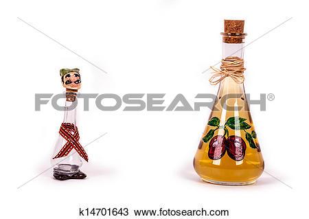 Stock Photo of Dram and plum brandy bottle k14701643.
