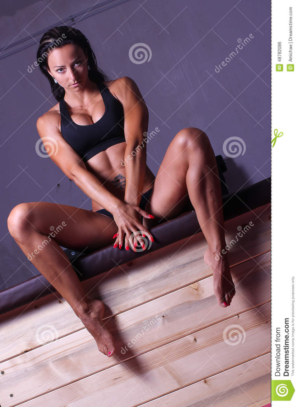 A Women Sitting On Stack Of Plyometric Boxes At The Gym Stock.