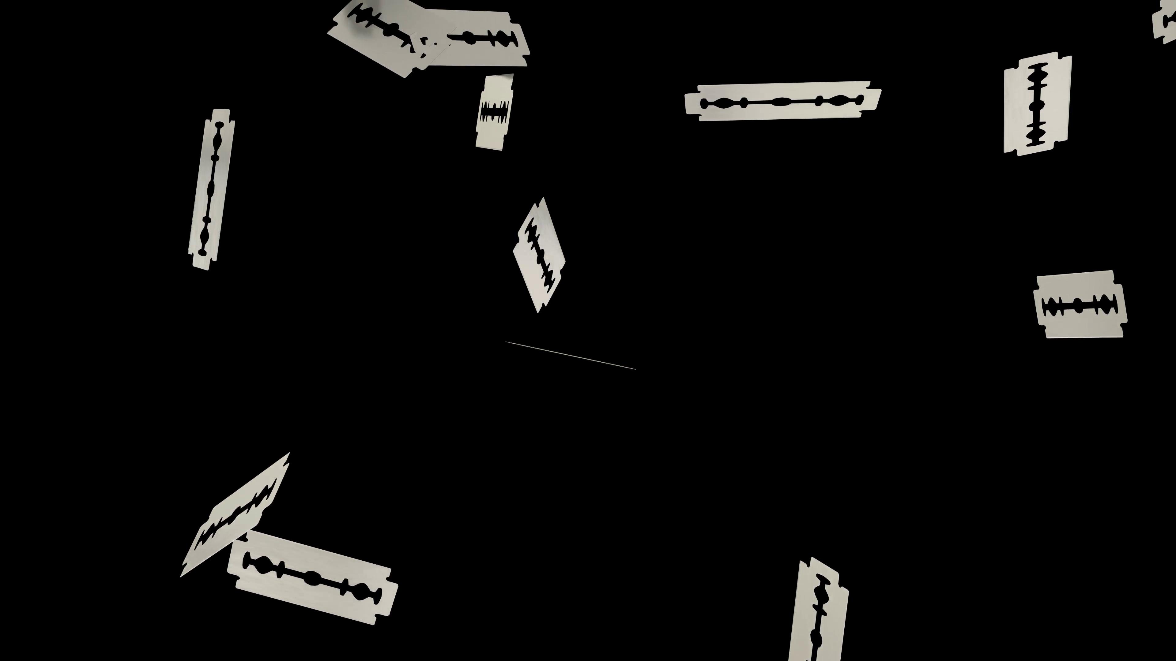 Animated light rain of plain razor blades against transparent background.  Alpha channel embedded wit 4k PNG file. Motion Background.