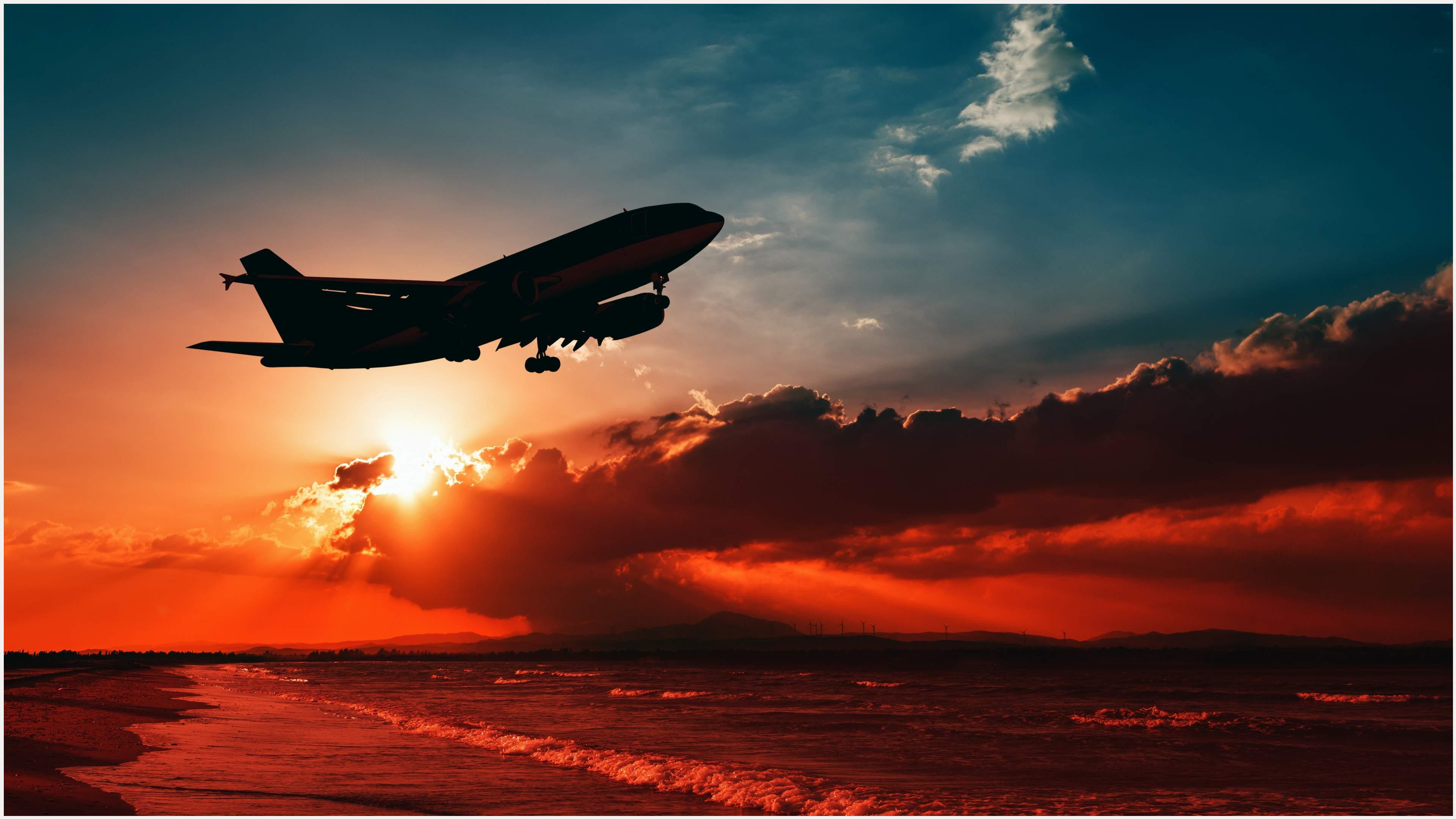 Plane Flying Over Sea 4K Wallpaper.