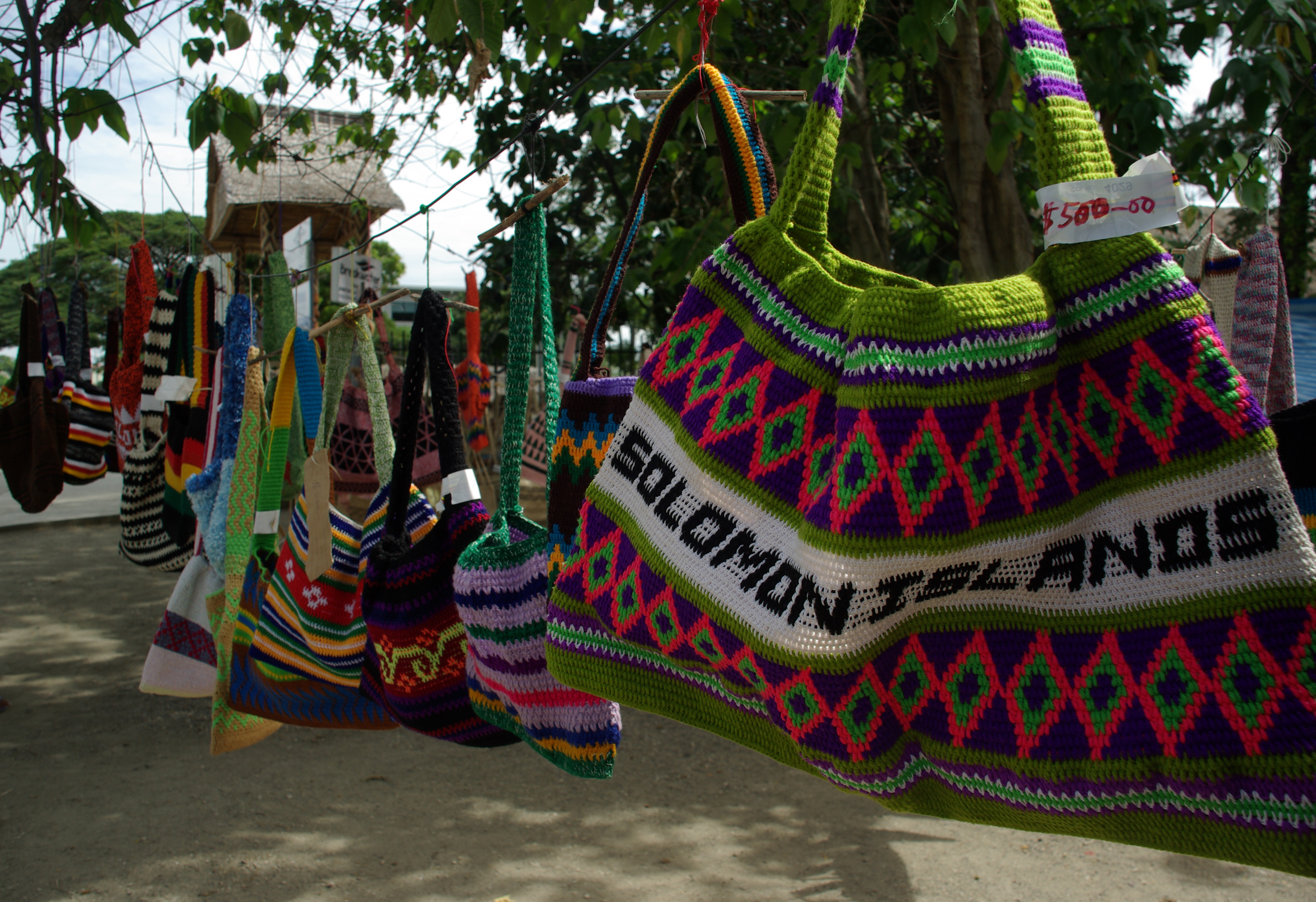 File:Bilums (Traditional bags from PNG) hang for sale from a.
