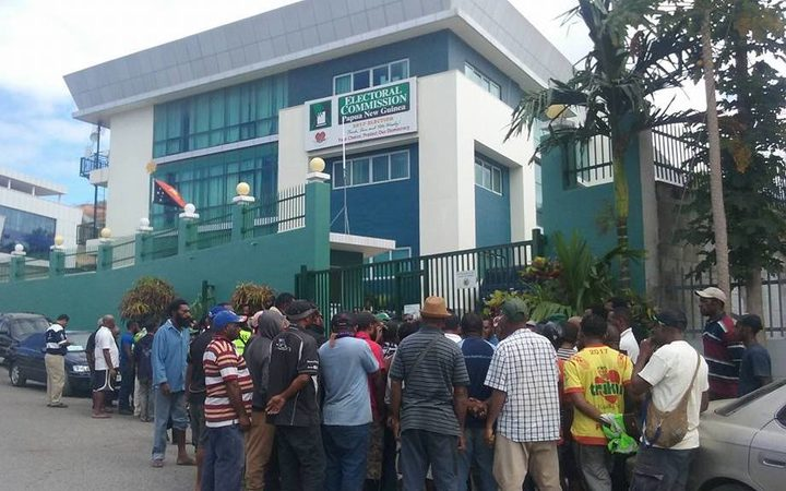 Senior election officials detained in PNG.