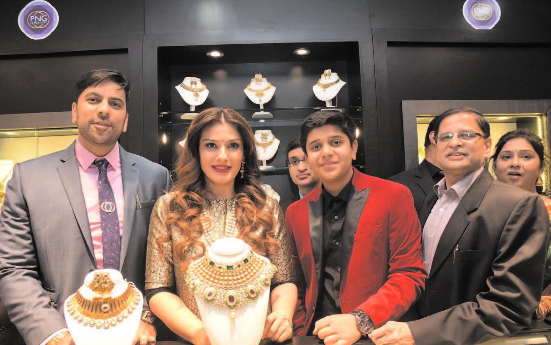 Raveena Tandon inaugurates PNG Jewelers Silver Jubilee store.