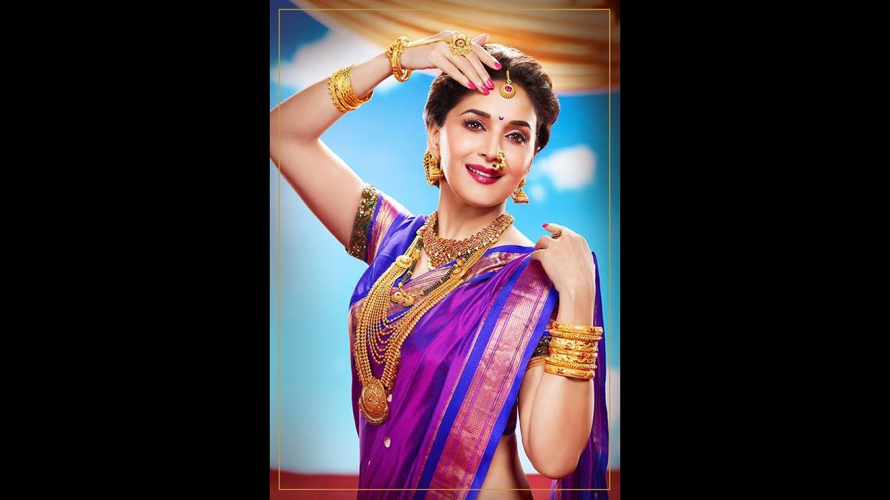 Madhuri Dixit in PNG Jewellery gold advertisement.