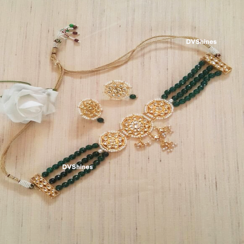 Light weight kundan choker with green beads.