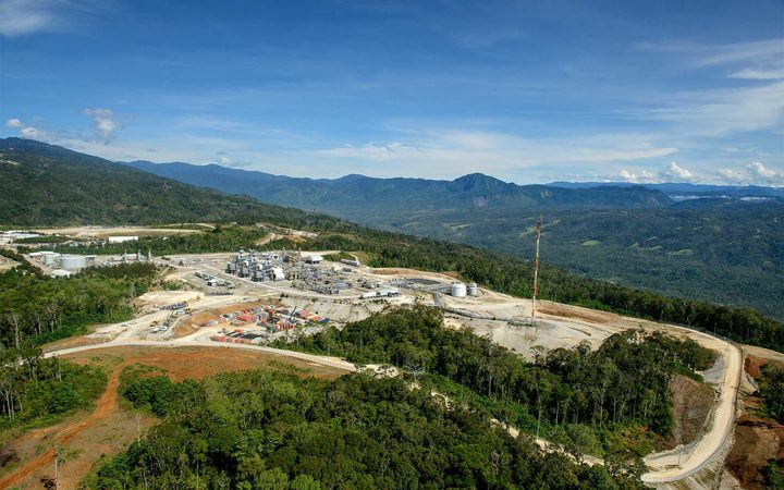 Exxon defends economic impact of PNG gas project.