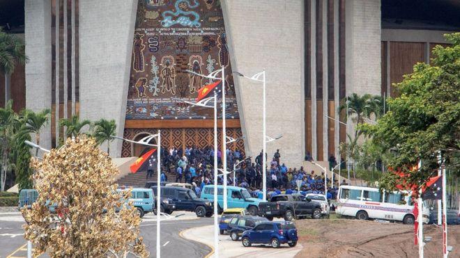 PNG security forces storm parliament over Apec pay dispute.