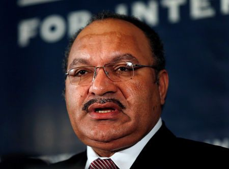 Papua New Guinea PM quits after turmoil, new leader due on.