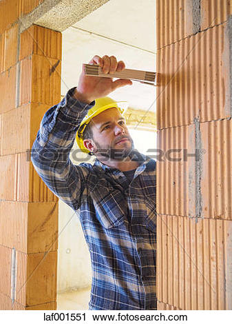 Stock Photography of Foreman with construction plan checking.