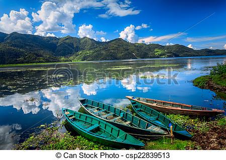 Stock Photography of Boats on Pokhara Fewa Lake in Nepal.