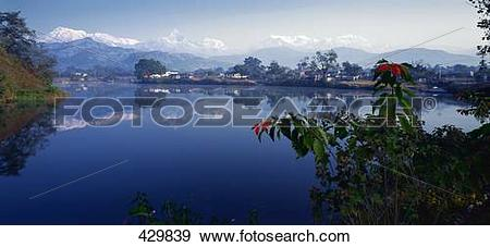Stock Photograph of Lake in front of mountain range, Annapurna.