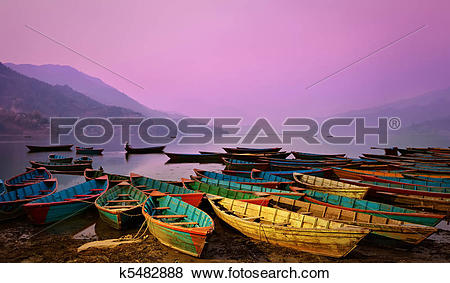 Pictures of Beautiful twilight landscape with boats on Phewa lake.