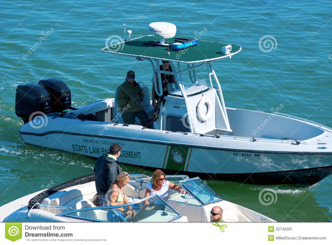 State Law Enforcement Police Boat Stopping A Boat Editorial Photo.