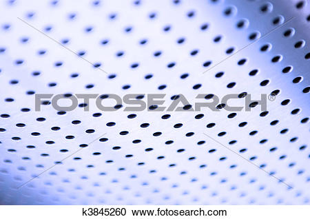 Stock Photography of Polished metal surface with the small holes.