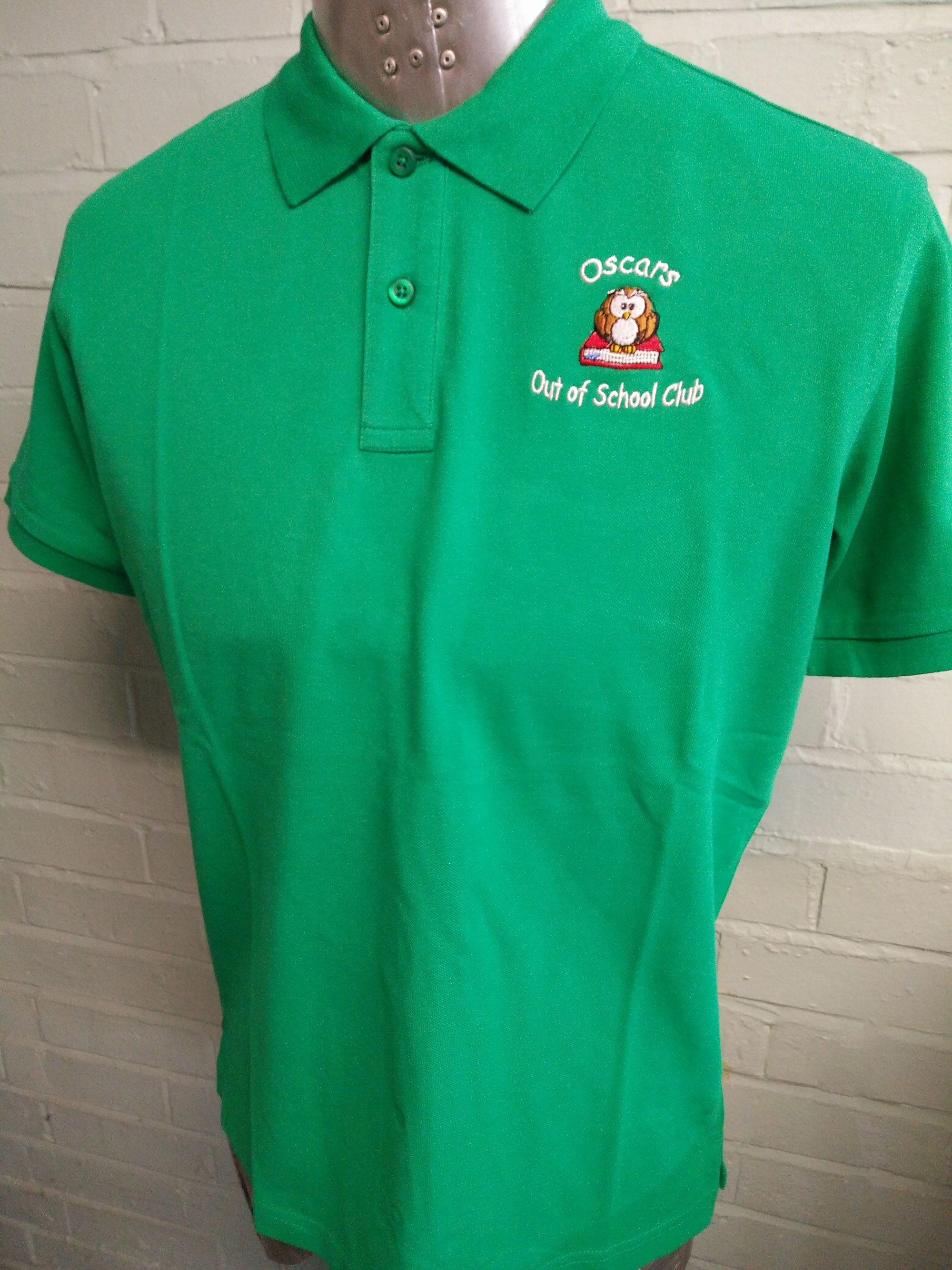 Custom logo embroidered polo shirts for Oscars Out of School.