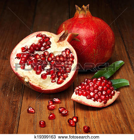 Stock Photo of juicy pomegranate open k19399163.