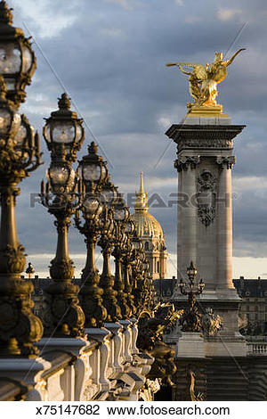 Stock Photo of France, Paris, Lamp posts and statues on Pont.
