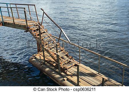 Stock Photography of Rusty metal ladder of pontoon bridge over.