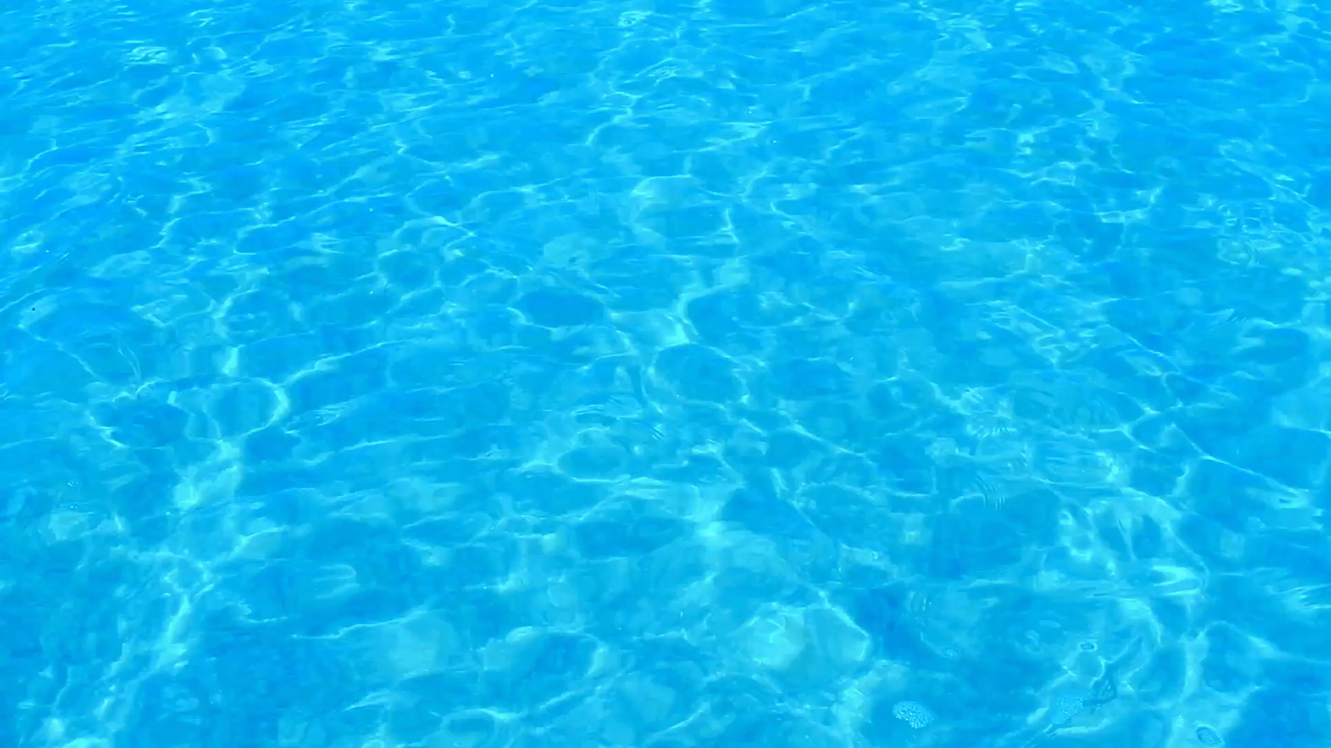 Beautiful refreshing blue swimming pool water Stock Video Footage.