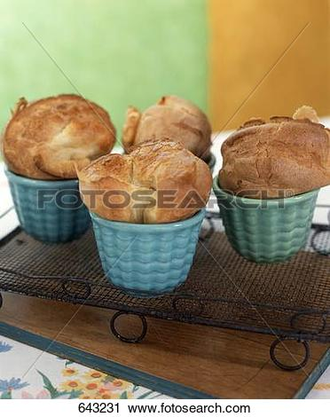 Stock Photography of Four Popovers in Ramekins on a Cooling Rack.
