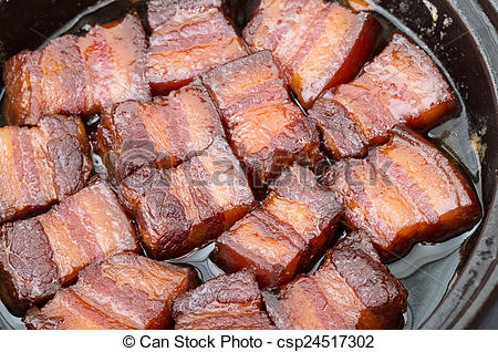 Stock Photography of Vietnamese caramelized pork belly in clay pot.