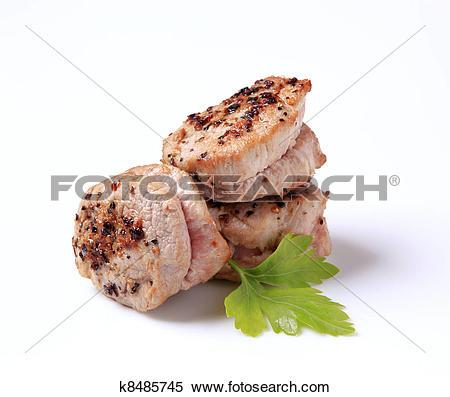 Stock Image of Pan roasted pork tenderloin medallions k8485745.
