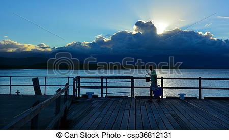 Stock Photos of Fisherman fishing in Port Douglas Queensland.