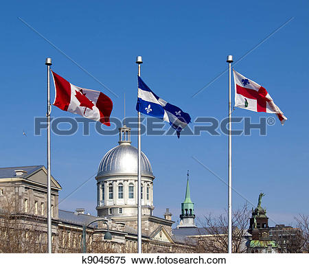 Stock Image of Flags of Canada, Quebec and Montreal in Old Port.