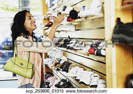 Stock Image of Hispanic woman at shoe store, Port Washington, New.