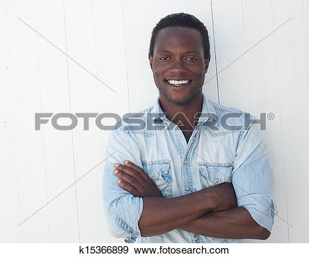 Stock Photograph of Portrait of a handsome black man with arms.