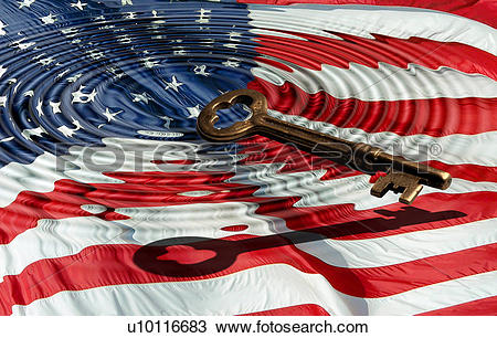 Stock Photo of A skeleton key casts a shadow over an American flag.